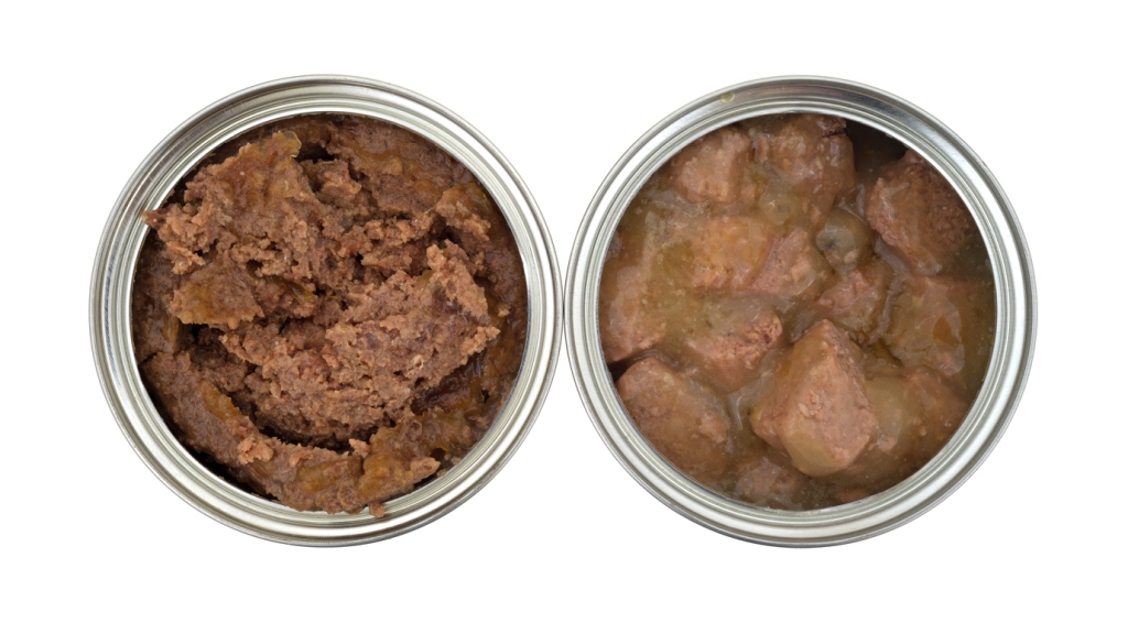 Top view of beef and chicken dog food cans opened on a white background.